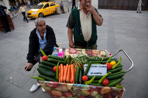 A street vendor in Istanbul's Galata neighborhood selling freshly peeled cucumbers and carrots. Photo by Jonathan Lewis.