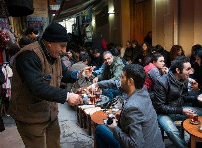 Mustafa Amca serving tea, photo by Monique Jaques