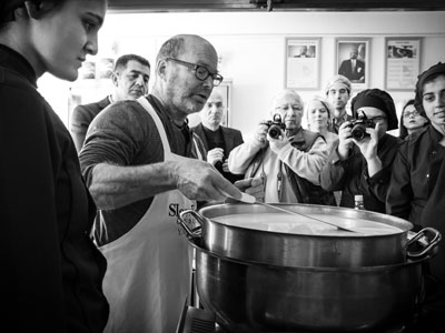 Cheesemaker Robert Paget teaches high schoolers how to make soft cheese at a Slow Cheese event, photo by Filiz Telek