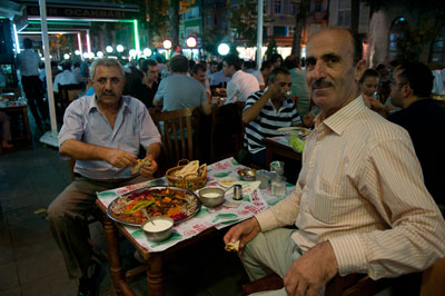 Two men enjoy iftar in Istanbul's Fatih neighborhood, photo by Fumie Suzuki