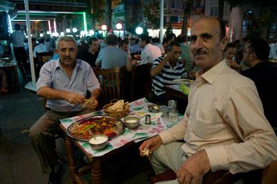 Two men enjoy iftar in Istanbul's Fatih neighborhood, photo by Fumie Suzuki