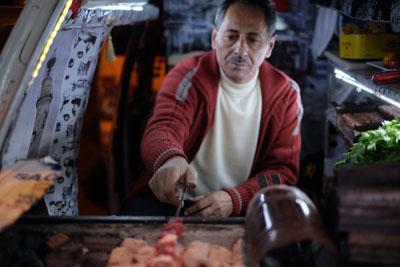 Süleyman Usta grilling out of Yıldırım Usta's van, photo by Paul Benjamin Osterlund