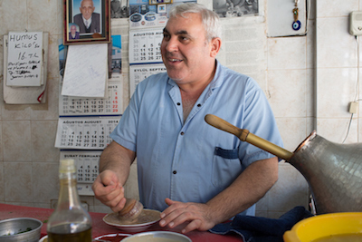 A man in a small shop in Antakya makes bakla ezmesi (fava bean paste) to order, photo by David Hagerman
