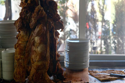 Newly roasted lambs hanging on a series of hooks at Kulu Büryan & Kebab Salonu, photo by Paul Benjamin Osterlund